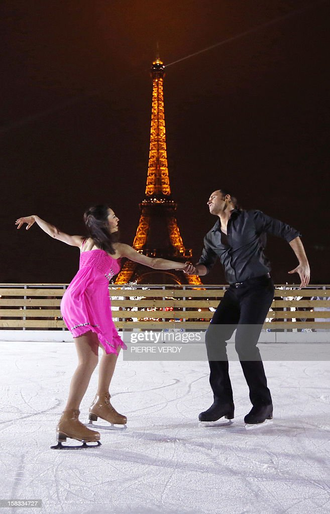 French international ice skater and choreographer, Florentina Houdiniere (L) and French ice skater Nicolas Branne, both working at the Bouglione Circus, perform during the inauguration of the 'Christmas village', on December 13, 2012, in Paris, as part of the 'Trocadero On Ice' event. An ice-skating rink opened to public in front of the Eiffel tower, and will run until January 6, 2013.