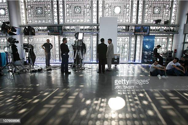 French international information TV 'France 24' employee wait 02 April 2007 at the institut du monde arabe in Paris prior to the launch of the...