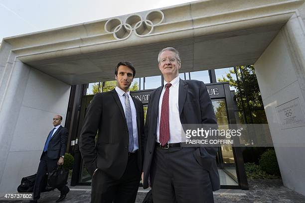 French International Olympic member Tony Estanguet and President of 'Association Ambition Olympique' Bernard Lapasset pose in front of the IOC...