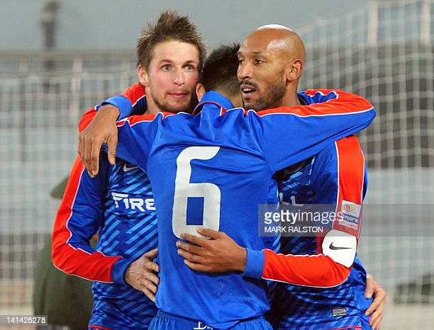 French International player Nicolas Anelka from the Shanghai Shenhua club celebrates after scoring his first goal with teammates Mario Bozic and Yu...