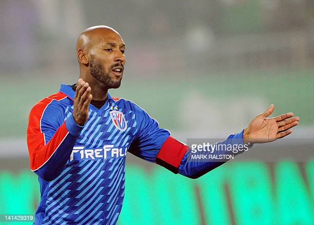French International player Nicolas Anelka from the Shanghai Shenhua club reacts during Shanghai Shenhua's 23 league match loss against Beijing Guoan...