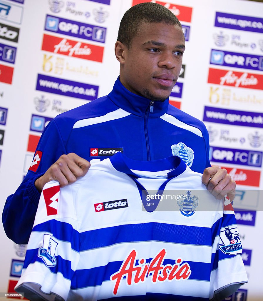 French international striker Loic Remy poses for pictures with his new Queens Park Rangers jersey during a press conference in London on January 18, 2013 after signing with the Premier League club from Marseille on a four-and-a-half-year contract.