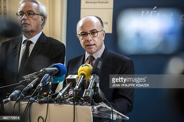 French Interoir Minister Bernard Cazeneuve gives a press conference in the Dijon prefecture eastern France on December 22 2014 a day after people...