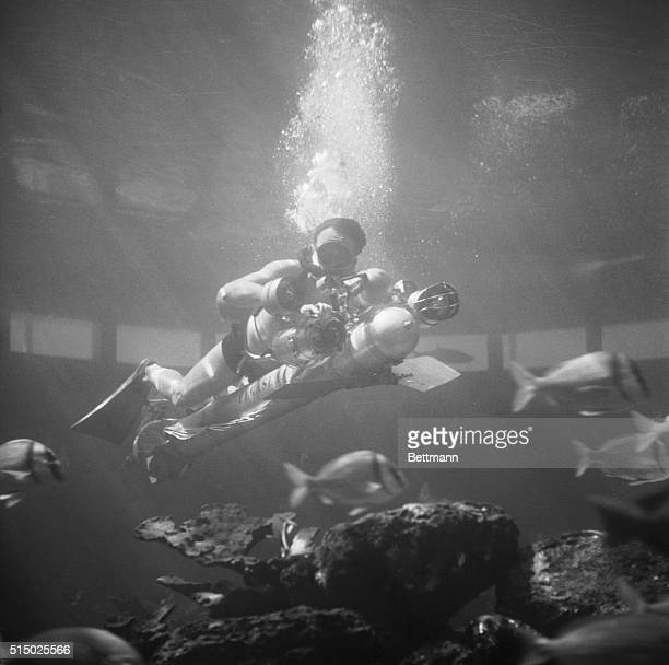 French inventor Dimitri Rebikoff demonstrates his Pegasus underwater vehicle at the Miami Seaquarium The Pegasus is propelled through the water by...