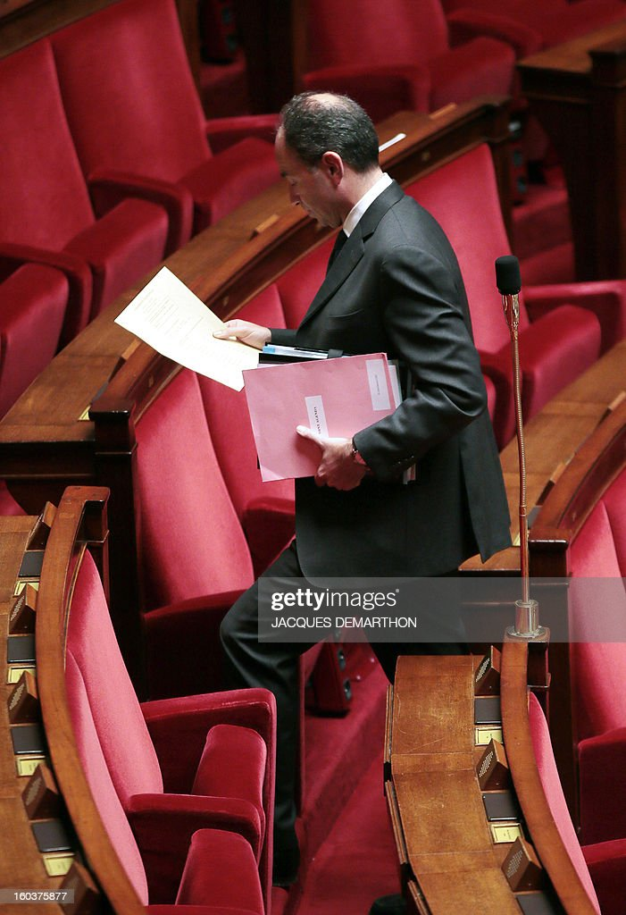 French Jean-Francois Cope, head of France's right-wing UMP opposition party, arrives prior a session of questions to the government at the National Assembly on January 30, 2013 in Paris. AFP PHOTO / JACQUES DEMARTHON