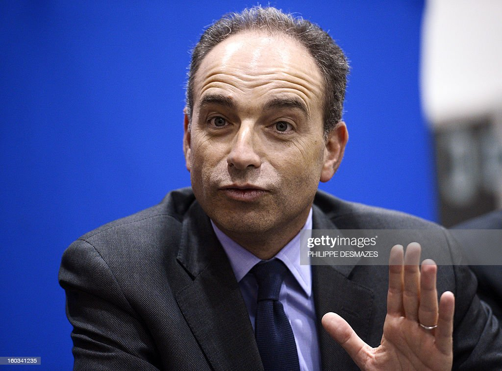 French Jean-Francois Cope, the head of France's right-wing UMP opposition, gestures as he delivers a speech during a meeting with militants on January 29, 2013 in Villeurbanne, near Lyon.