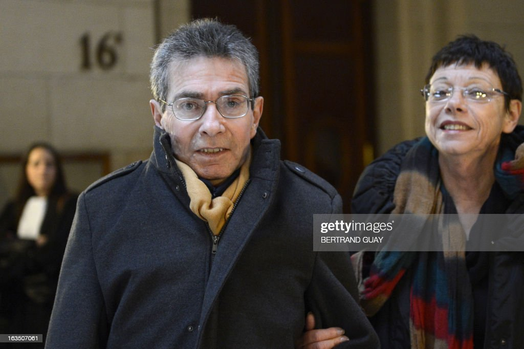 French Jean-Francois Tisser (L), one of the 'L'Ecole en bateau' (a training vessel) crew members, arrives at the Paris' courthouse on March 11, 2013 on the second week of the trial of Leonide Kameneff, the founder of 'L'Ecole en bateau' and three of his crew members who are charged for raping 14 teenagers schooling on their boat between 1980 and 1990. Only nine of them filed a complaint due to France's prescription rules . AFP PHOTO / BERTRAND GUAY