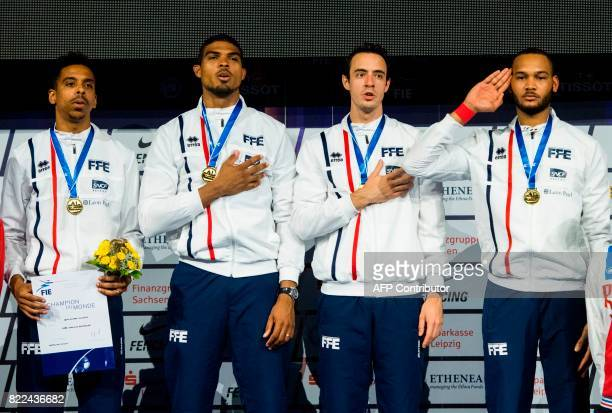 French JeanMichel Lucamy Yannick Borel Ronan Gustin and Daniel Jerent stand on the podium after winning the team men's epee final between Switzerland...
