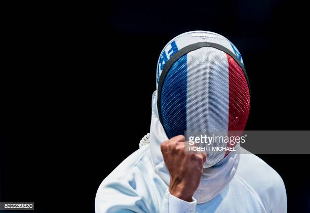 TOPSHOT French JeanMichel Lucenay celebrates during the team men's epee qualification between Russia and France at the World Fencing Championships on...