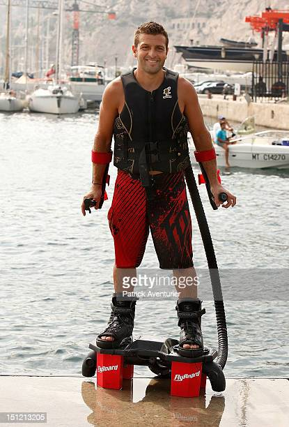French Jet Ski Champion Franky Zapata poses in the water with with his invention the Zapata Flyboard on August 26 2012 in Marseille France Franky...