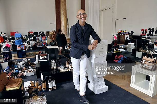 AGEORGES French jeweler and shoe designer Pierre Hardy poses in front of some of his creations on September 20 2012 in his office in Paris Hardy is...