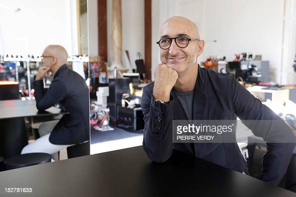 AGEORGES French jeweler and shoe designer Pierre Hardy poses on September 20 2012 in his office in Paris Hardy is notably Hermes' Creative Director...