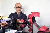 AGEORGES French jeweler and shoe designer Pierre Hardy poses with one of his creations on September 20 2012 in his office in Paris Hardy is notably...