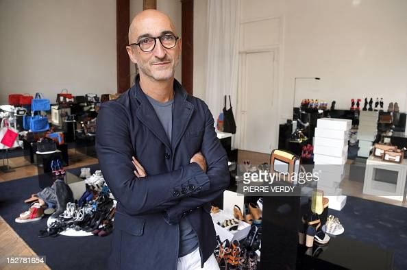 AGEORGES French jeweler and shoe designer Pierre Hardy poses with some of his creations on September 20 2012 in his office in Paris Hardy is notably...
