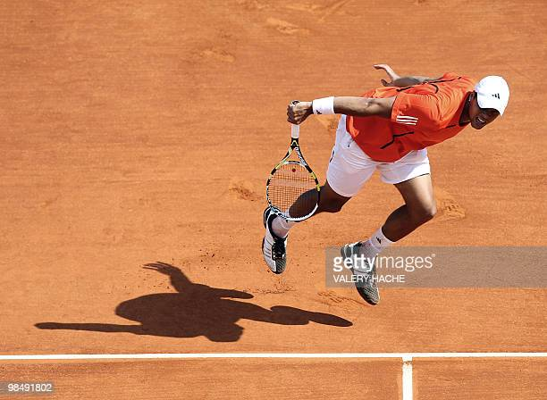 French Jo Wilfried Tsonga hits a return to Spanish Juan Carlos Ferrero at the ATP Monte Carlo Masters claycourt tournament on April 15 2010 in Monaco...