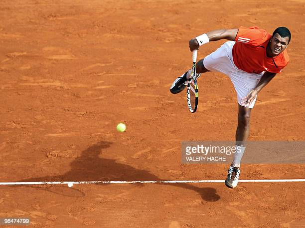 French Jo Wilfried Tsonga serves to Spanish Juan Carlos Ferrero at the ATP Monte Carlo Masters claycourt tournament on April 15 2010 in Monaco AFP...