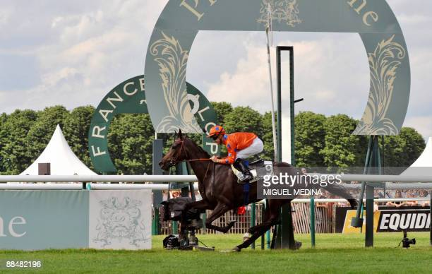 French jockey Christophe Lemaire crosses the finish line to win the 160th Prix de Diane horse racing with Stacelita on June 14 2009 in Chantilly a...