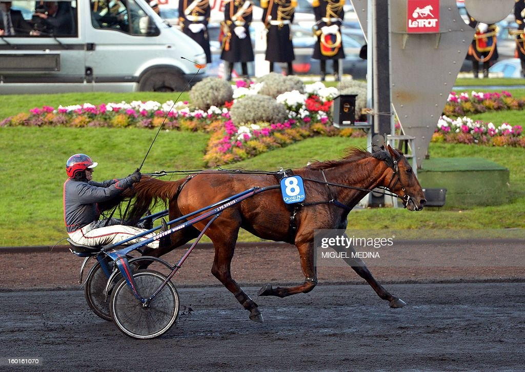 French jockey Jean-Philippe Dubois crosses the finish line of the 92nd Prix d'Amerique with French horse Royal Dream, during the most prestigious trotting race in Europe, on January 27, 2013 at the Vincennes racetrack, east of Paris. The race was created in 1920 to honor US soldiers who fought during World War I. AFP PHOTO / MIGUEL MEDINA