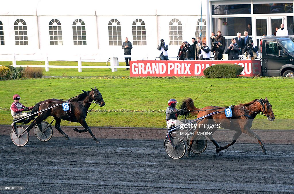 French jockey Jean-Philippe Dubois (R) with French horse 'Royal Dream', won the 92nd Grand Prix d'Amerique, the most prestigious trotting race in Europe, ahead Ready Cash with jockey Franck Nivard (L), on January 27, 2013 at the Vincennes racetrack, east of Paris. The race was created in 1920 to honor US soldiers who fought during World War I.