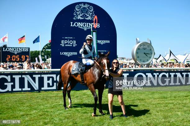 French jockey Stephane Pasquier celebrates as he poses for photographs with his horse Senga after winning the Prix de Diane a 2100meters flat horse...