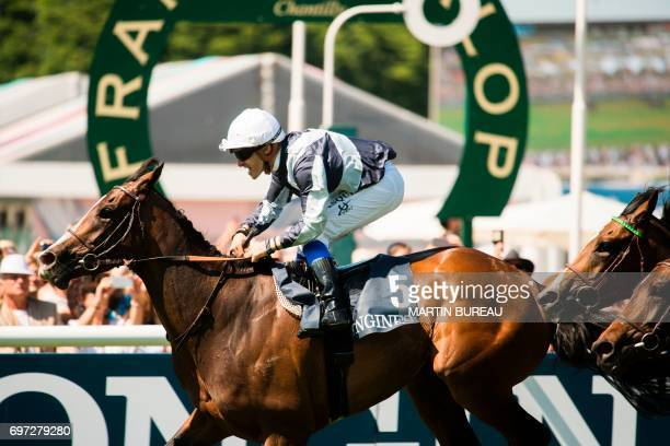 French jockey Stephane Pasquier rides his horse Senga as they cross the finish line and win the race of the Prix de Diane a 2100meters flat horse...