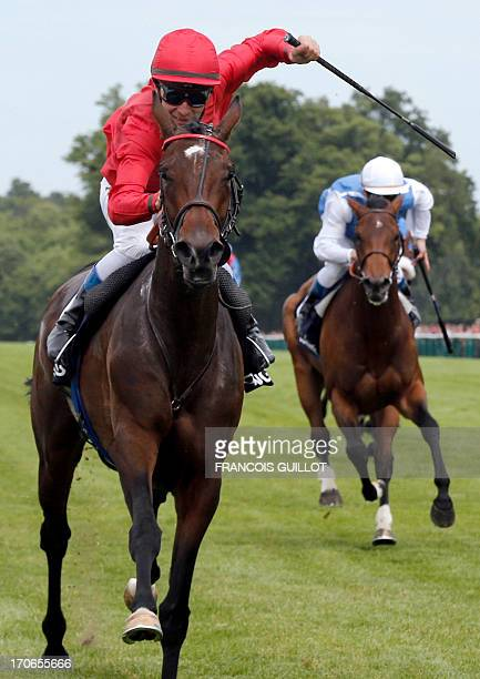 French jockey Thierry Jarnet is about to cross the finish line to win on Treve the 164th Prix de Diane a 2100metre flat horse race open to...