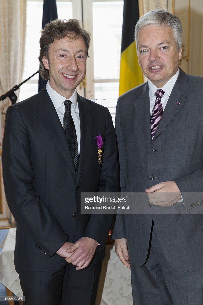 French journalist and author Stephane Bern (L) and Belgian Forein Minister and Vice Prime Minister Didier Reynders pose after Bern was appointed officer in the King Leopold order during a ceremony at Palais d'Egmont on March 7, 2013 in Brussels, Belgium.