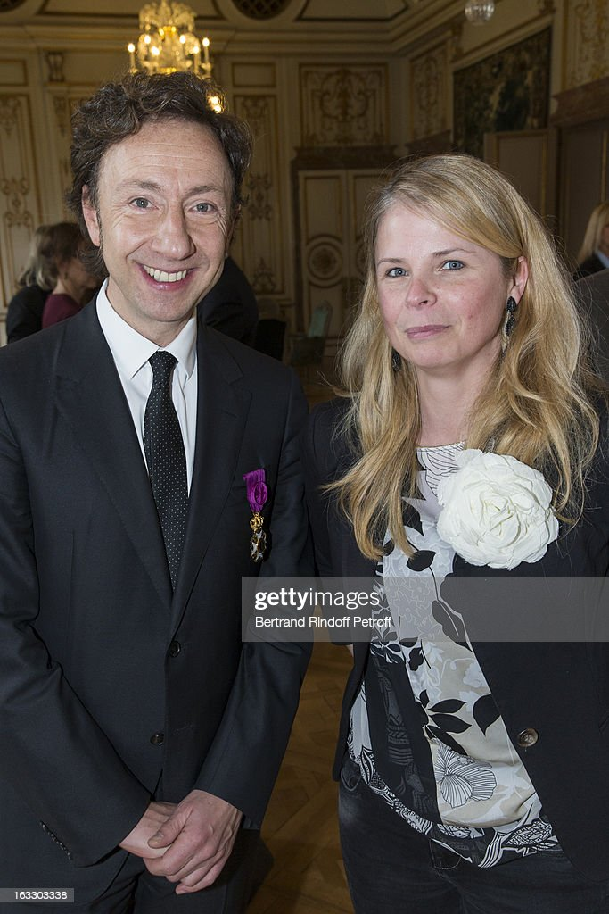 French journalist and author Stephane Bern (L) and Belgian reporter Kristin de Viiese pose after Bern was appointed officer in the King Leopold order during a ceremony at Palais d'Egmont on March 7, 2013 in Brussels, Belgium.