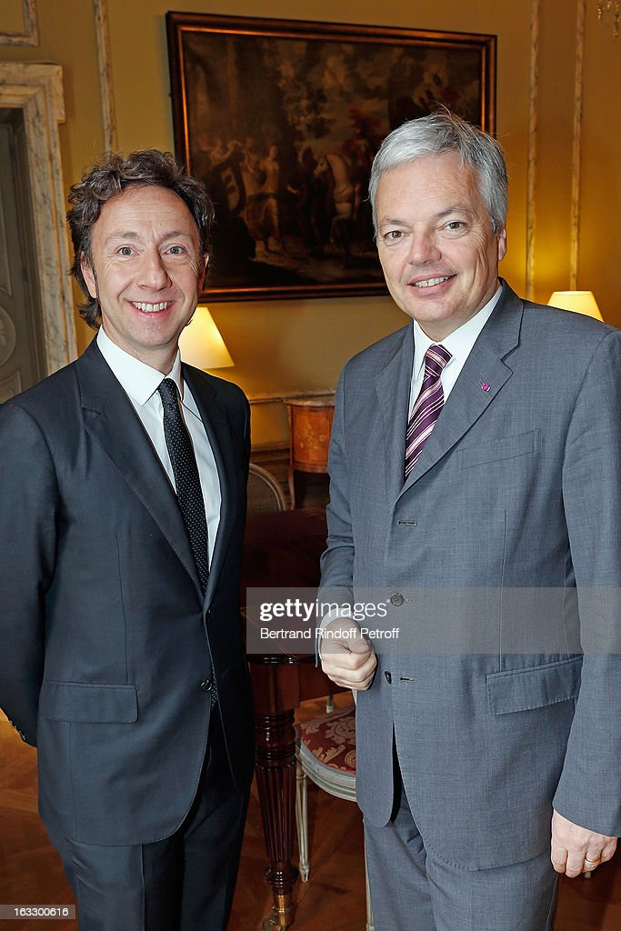 French journalist and author Stephane Bern (L) and Countess Belen de Limburg-StirumBelgian Foreign Minister and Vice Prime Minister pose prior Bern to be appointed officer in the King Leopold order during a ceremony at Palais d'Egmont on March 7, 2013 in Brussels, Belgium.