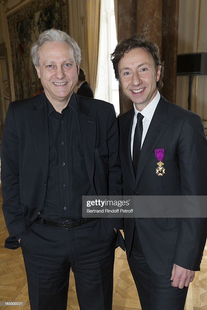 French journalist and author Stephane Bern (R) and Yves Bigot, CEO TV5, pose after Bern was appointed officer in the King Leopold order during a ceremony at Palais d'Egmont on March 7, 2013 in Brussels, Belgium.