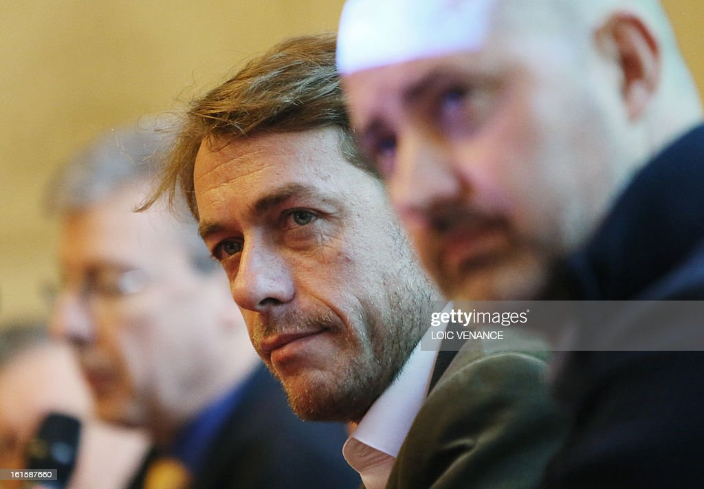 French journalist and documentary filmmaker Stephane Gabet(C) speaks during a press conference in Paris on February 12, 2013, to present the reconstruction of the head of French King Henri IV (1553-1610). Gabet is at the start of the rediscovery of the skull. This reconstruction was made three years after a panel of forensic scientists identified the skull of the king who was murdered at the age of 57 on May 14, 1610, by a fanatic. Scientists headed by France's Philippe Charlier found a common genetic profile between the mummified head of Henri IV and dried blood from his descendant, Louis XVI.