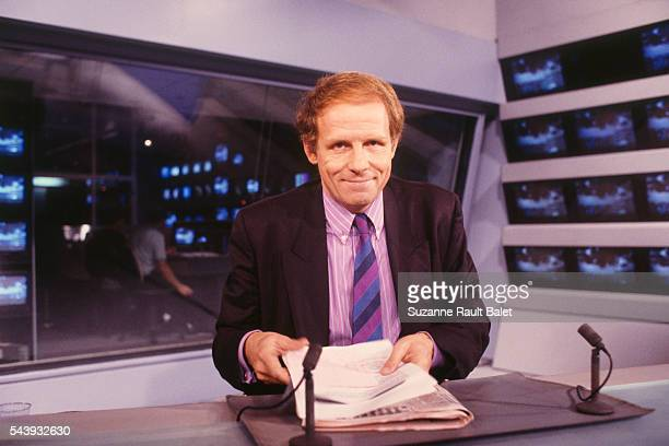 French journalist and newscaster Patrick Poivre d'Arvor on the set of the evening news for French channel TF1