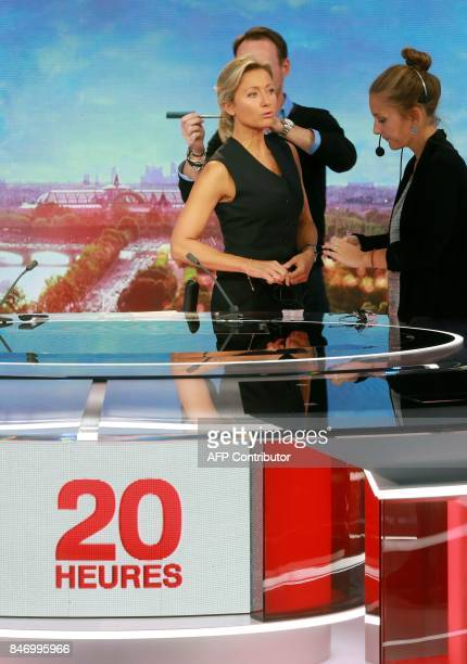 French journalist and TV host AnneSophie Lapix is being prepared on the set before presenting the broadcast news of the French TV channel France 2 in...