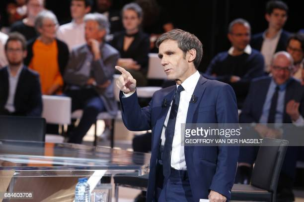 French journalist and TV host David Pujadas gestures before the start of the political TV show 'L'emission politique' on May 18 2017 on a set of...