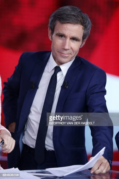 French journalist and TV host David Pujadas poses before the start of the political TV show 'L'emission politique' on May 18 2017 on a set of French...