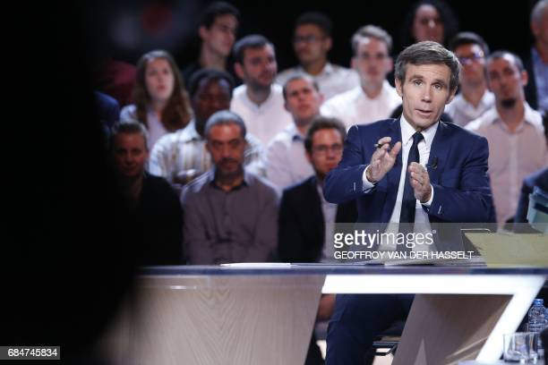 French journalist and TV host David Pujadas speaks during the political TV show 'L'emission politique' on May 18 2017 on a set of French television...