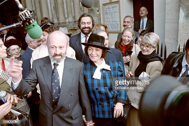 French journalist and writer Antoine Blondin and Francoise Barrere pose during their wedding ceremony on November 08 1988 in Paris AFP PHOTO DERRICK...