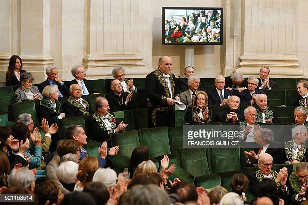 French journalist and writer Marc Lambron is applauded by other members after being inducted into the Academie Francaise in Paris on April 14 2016 /...