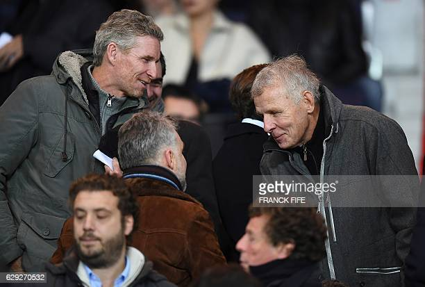 French journalist and writer Patrick Poivre D'arvor and French TV presenter Denis Brogniart attend the French L1 football match between Paris...