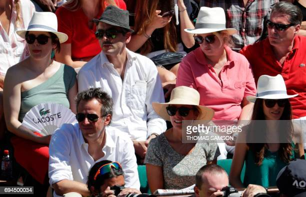 French journalist AnneSophie Lapix and her husband French businessman Arthur Sadoun attend the final tennis match between Romania's Simona Halep and...