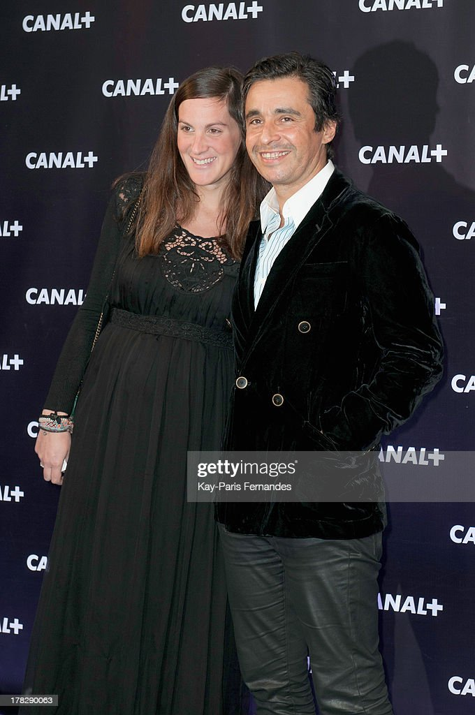 French journalist Ariel Wizman (r) with his wife Osnath Assayag at the 'Rentree De Canal +' photocall at Porte De Versailles on August 28, 2013 in Paris, France.