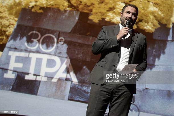 French journalist Bruce Toussaint hosts the opening of the 30th annual FIPA in Biarritz on January 24 2017 / AFP / IROZ GAIZKA