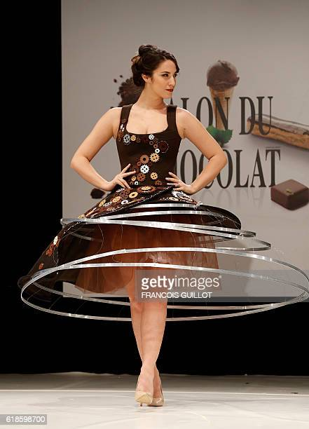 French journalist Charlotte Namura presents an creation by AnneLise DuriezGrandjean and chocolatier Vianney Bellanger during the 22nd Chocolate Fair...