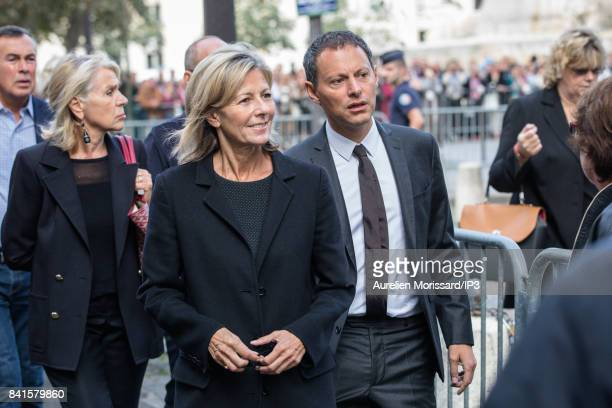 French journalist Claire Chazal and French radio and television host Marc Olivier Fogiel attend Mireille Darc's Funeral at Eglise Saint Sulpice at...