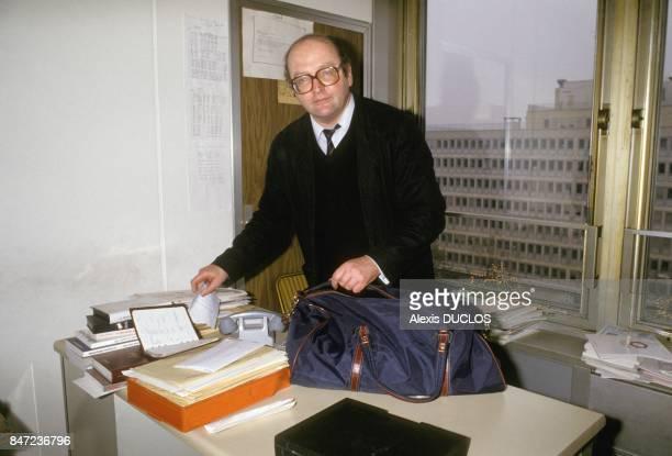 French journalist Dominique Jamet leaves 'Quotidien de Paris' newspaper on December 15 1987 in Paris France
