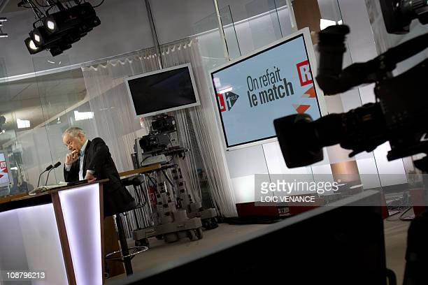 French journalist Eugene Saccomano hosts the 'On refait le Match' TV show on I Tele news channel on January 31 2011 in Paris AFP PHOTO LOIC VENANCE