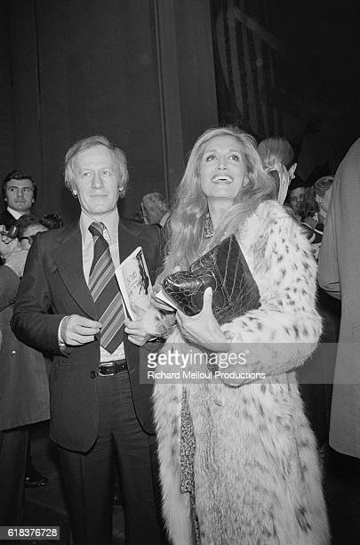 French journalist Jacques Chancel and popular Egyptian singer Dalida attend an anniversary party in Paris to celebrate the 200th broadcast of...