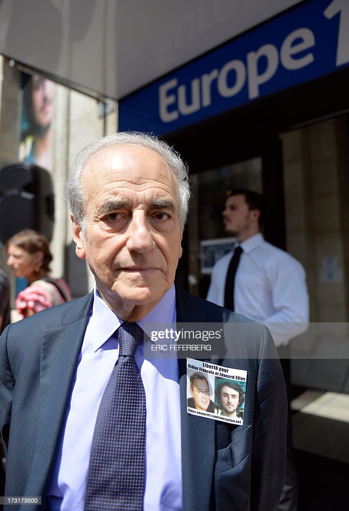 French journalist Jean-Pierre Elkabbach poses for a photograph as he takes part in a rally in front of Europe 1 radio station studio on July 9, 2013 in support of the two French radio journalists Didier François and Edouard Elias who have been kidnapped in Syria. AFP PHOTO / ERIC FEFERBERG