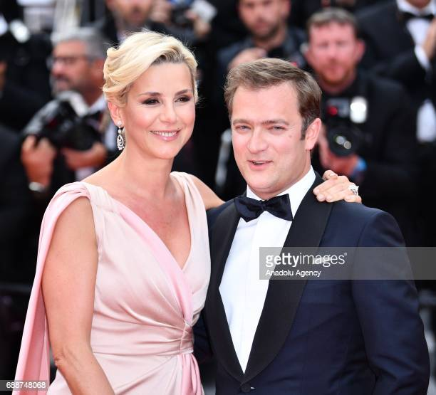 French journalist Laurence Ferrari and her companion French violinist Renaud Capucon arrive for the premiere of the film L'amant Double in...