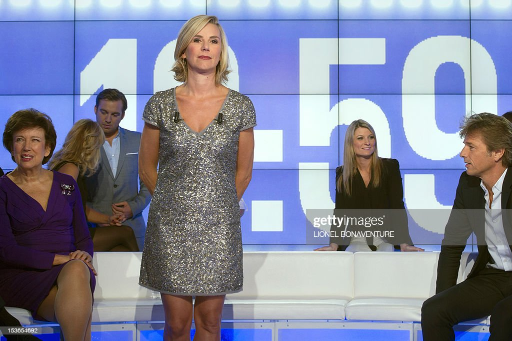 French journalist Laurence Ferrari poses during the official launching of the French D8 TV channel on October 7, 2012 in Paris. D8 is the new name of Direct 8 that Canal + group bought to French Bollore group. Ferrari will host the program 'Le Grand 8' with former minister Roselyne Bachelot, Hapsatou Sy and journalists Elisabeth Bost and Audrey Pulvar. AFP PHOTO LIONEL BONAVENTURE